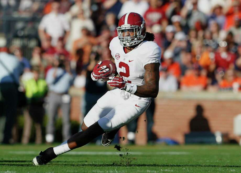 Alabama running back Derrick Henry rushed for 271 yards against Auburn on Saturday. Photo: Butch Dill — The Associated Press   / FR111446 AP