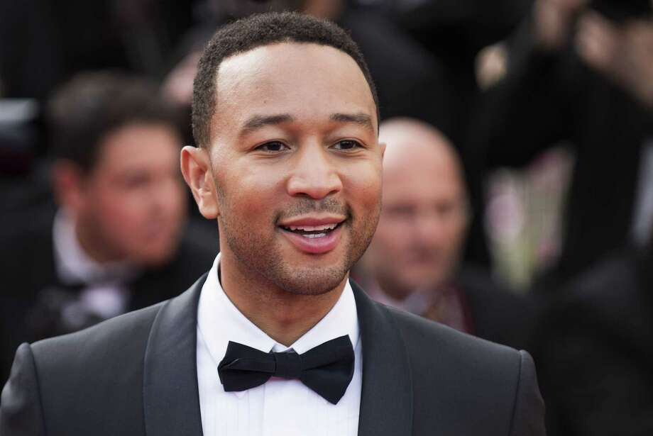 "In this May 13, 2015 photo, John Legend arrives for the opening ceremony and the screening of the film ""La Tete Haute"" (Standing Tall), at the 68th international film festival, Cannes, southern France. Photo: Photo By Arthur Mola/Invision/AP, File   / Invision"