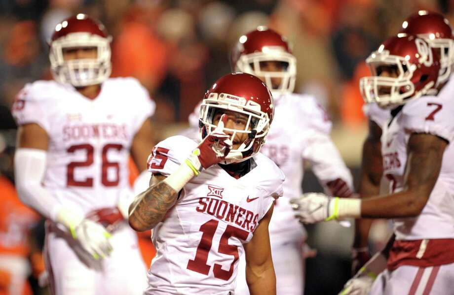Oklahoma cornerback Zack Sanchez gestures to Oklahoma State fans following a teammate's touchdown on Saturday. Photo: Brody Schmidt — The Associated Press   / FR79308 AP