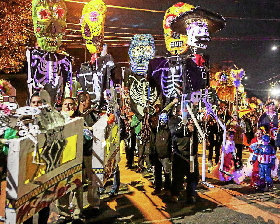 Some 250 marchers took the streets of Fair Haven Saturday evening for the Fifth annual Day of the Dead parade, or Dia de los Muertos. Photo: John Vanacore — New Haven Register / John Vanacore/New Haven Register