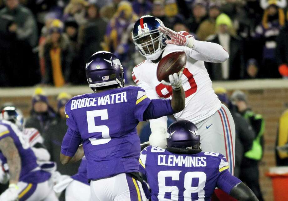New York Giants defensive end Jason Pierre-Paul (90) said Wednesday he would like to remain with the team. Photo: Andy Clayton-King — The Associated Press   / FR51399