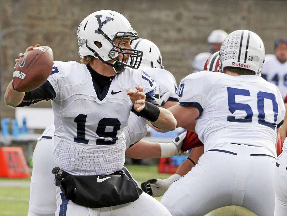 Yale quarterback Morgan Roberts (19) looks to throw a pass during the first half of their NCAA college football game against Harvard at Harvard Stadium Saturday, Nov. 22, 2014 in Cambridge, Mass. Harvard defeated Yale 31-24 to remain undefeated and win the Ivy League Championship.  (AP Photo/Stephan Savoia) Photo: AP / AP
