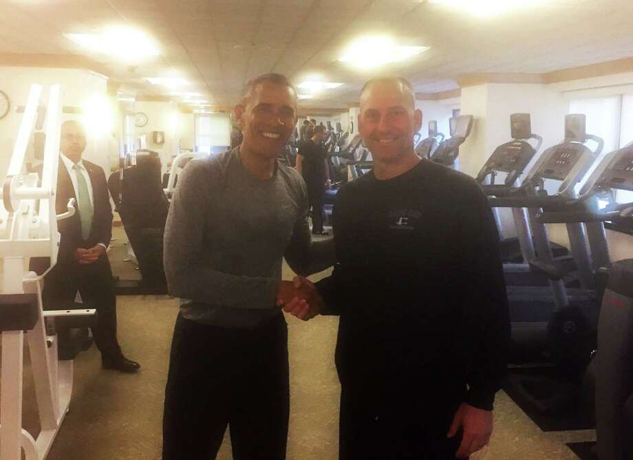 In this photo provided by the Boston Red Sox, President Barack Obama, left, shakes hands with Boston Red Sox Interim Manager Torey Lovullo in the exercise room of the New York Palace Hotel, Tuesday, Sept. 29, 2015, in New York. (Mike Hazen/Boston Red Sox via AP) MANDATORY CREDIT Photo: AP / Boston Red Sox