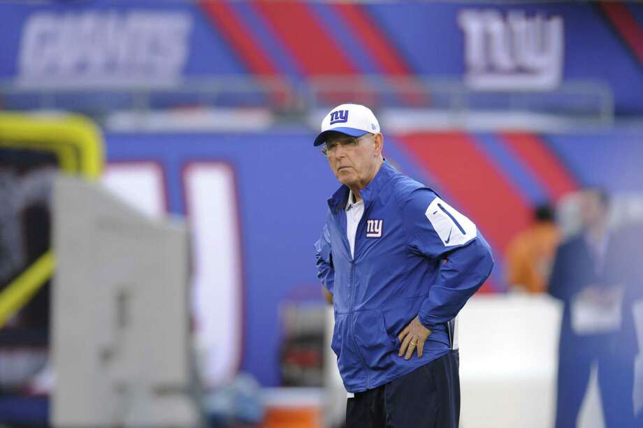 Giants head coach Tom Coughlin watches his team before Saturday's preseason game against the Jets. Photo: Bill Kostroun — The Associated Press   / FR51951 AP