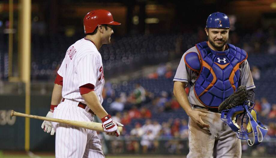 The Phillies' Chase d'Arnaud, left, has a word with his brother, New York Mets catcher Travis d'Arnaud , right, before his at bat during the seventh inning  Tuesday. The Philadelphia Phillies won 4-3. Photo: Chris Szagola  — The Associated Press   / FR170982 AP