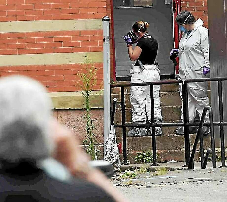 New Haven Police and the Connecticut State Police investigate a vacant building at 301 George St. and at 274 Crown St. that share a parking lot. Photo: Peter Hvizdak - New Haven Register