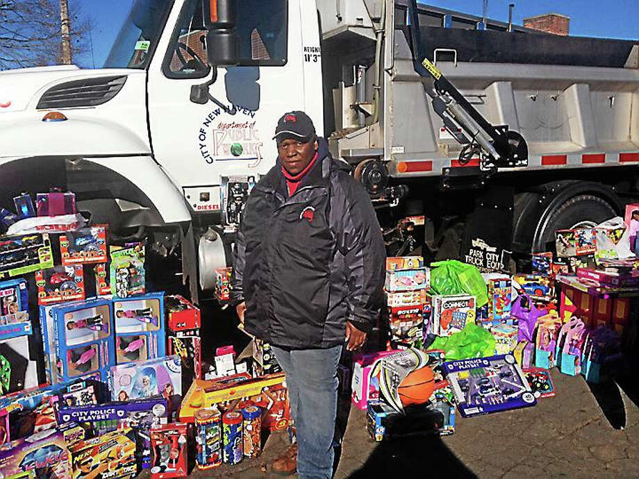 Pam McLoughlin — New Haven Register  Honda Smith leads volunteers collecting toys Sunday at New Haven Department of Public Works headquarters at 34 Middletown Ave. Photo: Journal Register Co.