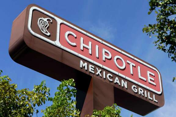 "FILE - This Monday, Feb. 8, 2016, file photo shows the sign at a Chipotle restaurant. A state health official says a second person has tested positive for norovirus after eating at a Chipotle in Sterling, Va., before it was temporarily closed on Monday, July 17, 2017, following reports of illnesses. Chipotle reopened the suburban Washington, D.C., location Wednesday, July 19, after a ""complete sanitization."" (AP Photo/Alan Diaz, File)"