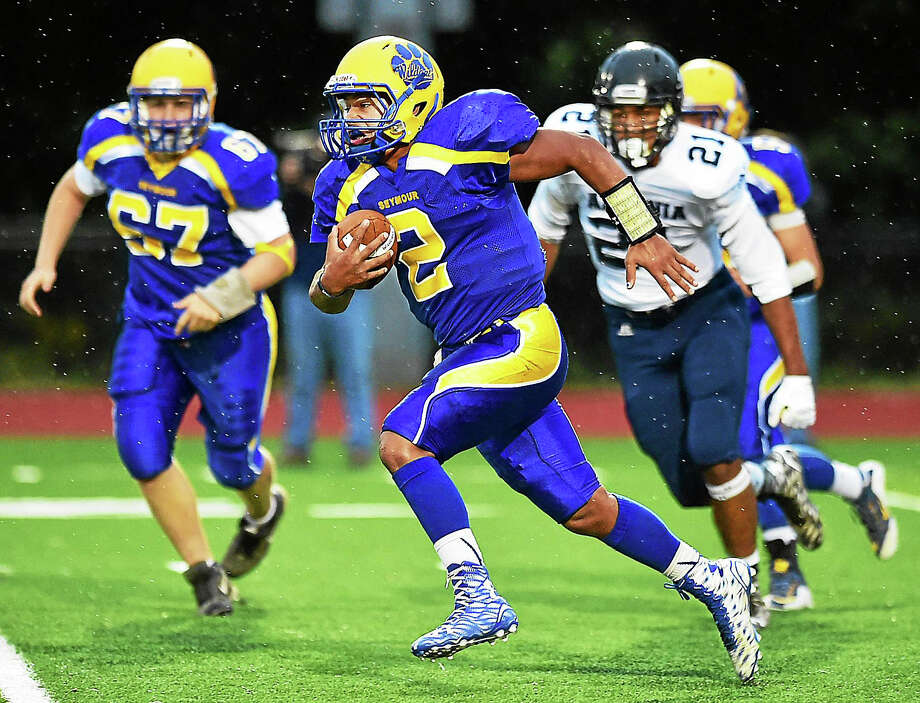 Seymour's Jaylen Kelley runs past an Ansonia defender in the Wildcats' Oct. 1 game against the Chargers. Photo: Photo Catherine Avalone — New Haven Register   / Catherine Avalone/New Haven Register