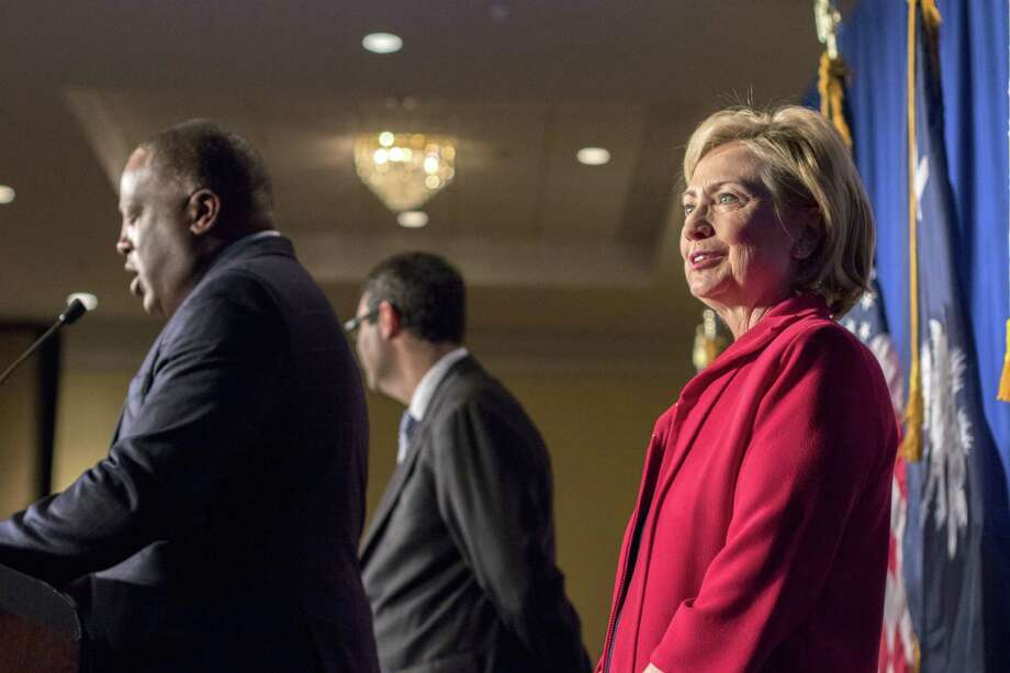 Democratic presidential hopeful Hillary Rodham Clinton is introduced by Columbia Mayor Steve Benjamin during a Hillary For American Discussion with Mayors and Local Official event Thursday in Columbia, S.C. Photo: AP Photo   / FR56856 AP