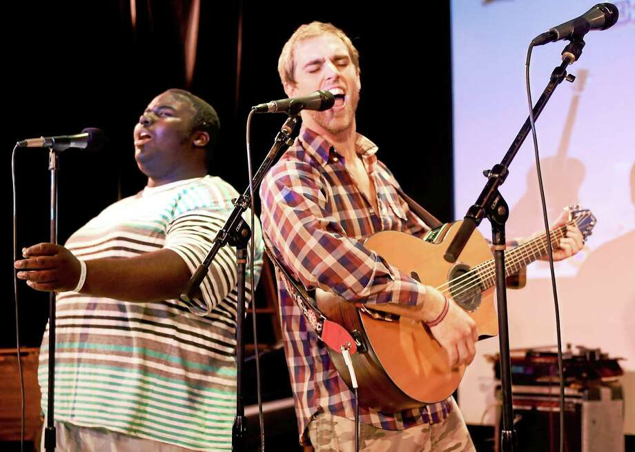 Singer, guitarist and pianist Jeremiah Brown of New Haven, 16, left, and singer, songwriter, guitarist and founder of Musical Intervention Adam Christoferson of Hamden, 31, rehearsal earlier this week at Lyric Hall, 827 Whalley Ave. in New Haven. Photo: Peter Hvizdak - New Haven Register   / ©2015 Peter Hvizdak