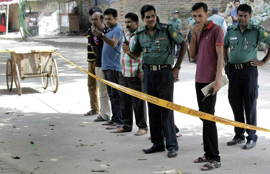 Members of Bangladeshi police and detective branch stand by the site where Italian citizen Cesare Tavella was gunned down by unidentified assailants in Dhaka, Bangladesh, Tuesday, Sept. 29, 2015. The Islamic State militant group claimed responsibility for gunning down the Italian citizen on the street in the diplomatic quarter of Bangladesh's capital, according to an intelligence group monitoring jihadist threats. Photo: AP Photo/ A.M. Ahad    / AP