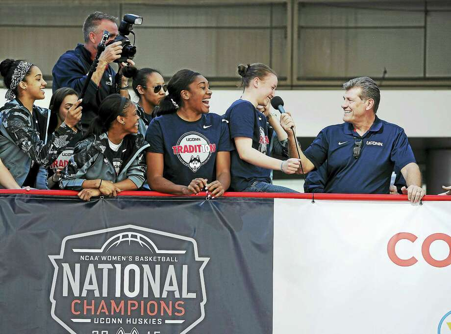 Members of the UConn women's basketball team laugh as head coach Geno Auriemma, right, puts Ansonia's Tierney Lawlor on the spot during a celebration of the program's 10th national championship on April 12 in Hartford. Photo: Jessica Hill — The Associated Press File Photo   / FR125654 AP