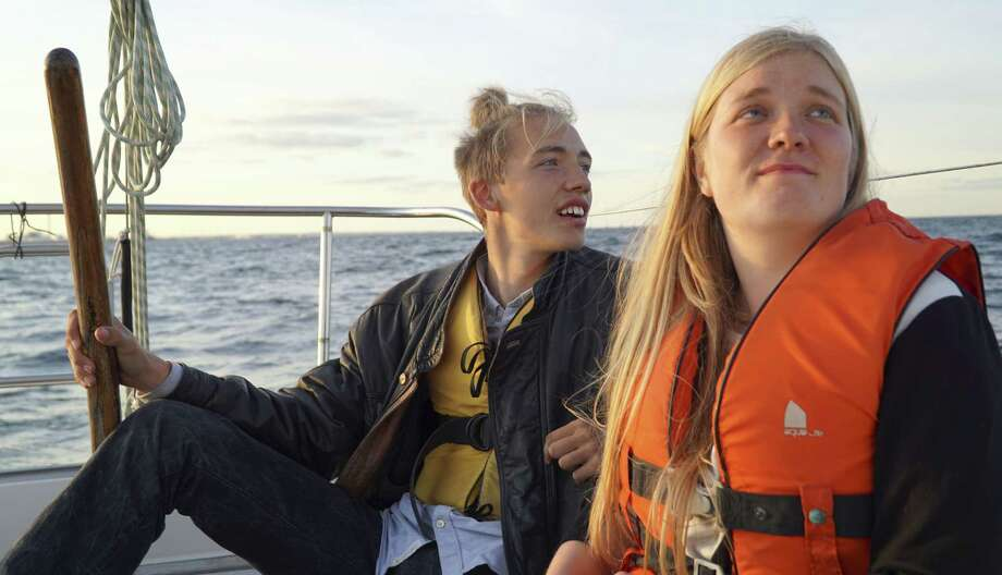 In this Sept. 9, 2015, photo, Annika Holm Nielsen, right, and Calle Vangstrup sail in the Oresund strait between Copenhagen and Malmo, Sweden. A 24-year-old Danish woman sails refugees across windy straits to safety in Sweden. A Romanian, whose forebears were driven from their homeland, opens his house to todayís migrants. A girl brings pens and paper to migrant children sleeping at a Milan train station. While European governments string razor wire across borders and argue over asylum rules, ordinary citizens are taking action to cope with an unprecedented inflow of migrants, their generosity offering moments of hope for the newcomers _ and for Europe itself. Photo: AP Photo/David Keyton   / AP