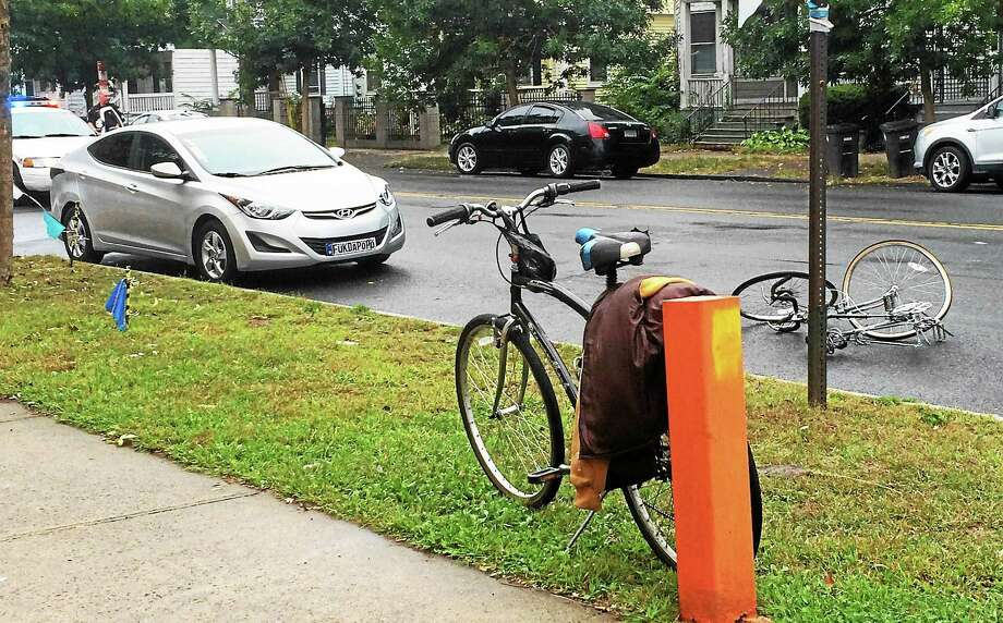 A man was hurt and part of Ella T. Grasso Boulevard near Whalley Avenue in New Haven was shut down Tuesday morning after a car hit a bicyclist, police said. The man was taken to Yale-New Haven Hospital. Photo: Wes Duplantier — New Haven Register