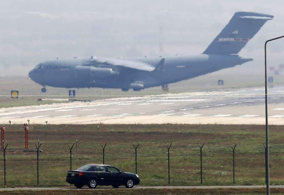 A United States Air Force cargo plane maneuvers on the runway after it landed at the Incirlik Air Base, in the outskirts of the city of Adana, southern Turkey, Thursday. Turkish Foreign Ministry spokesman Tanju Bilgic said Wednesday, that an agreement allowing the U.S.-led coalition against the IS to launch airstrikes from Incirlik and other Turkish bases has been approved by Cabinet. Photo: AP Photo   / AP