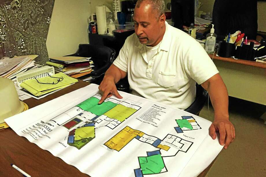 Jason Bartlett, New Haven's Youth Services Director, examines a schematic of the Escape Teen Center facility on Tuesday, August 25 in his office at City Hall. The city is set to sign a lease with Bethel AME Church next month to begin development of the facility on Orchard Street. Esteban L. Hernandez New Haven Register Photo: Journal Register Co.
