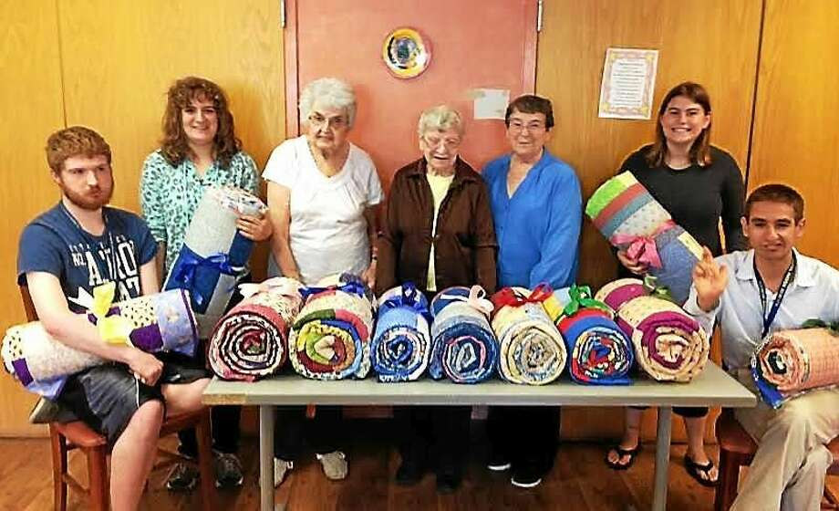 Oxford Senior Center members have donated colorful, handmade quilts to students at Chapel Haven in New Haven. contributed photo Photo: Journal Register Co.