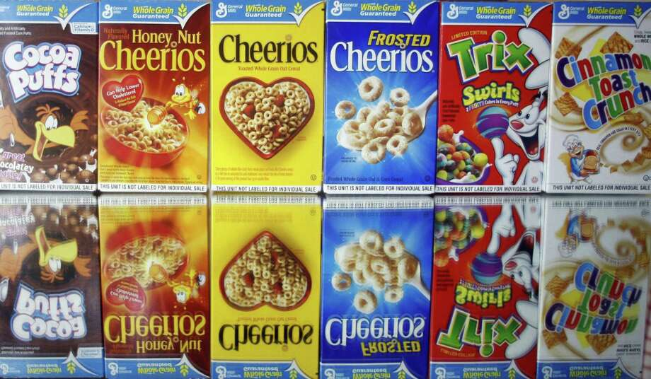 This March 22, 2011 photo shows boxes of General Mills cereals in Portland, Ore. Photo: AP Photo/Rick Bowmer, File   / AP