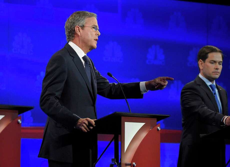 Jeb Bush, left, speaks as Marco Rubio looks on during the CNBC Republican presidential debate at the University of Colorado Wednesday in Boulder, Colo. Photo: The Associated Press   / AP