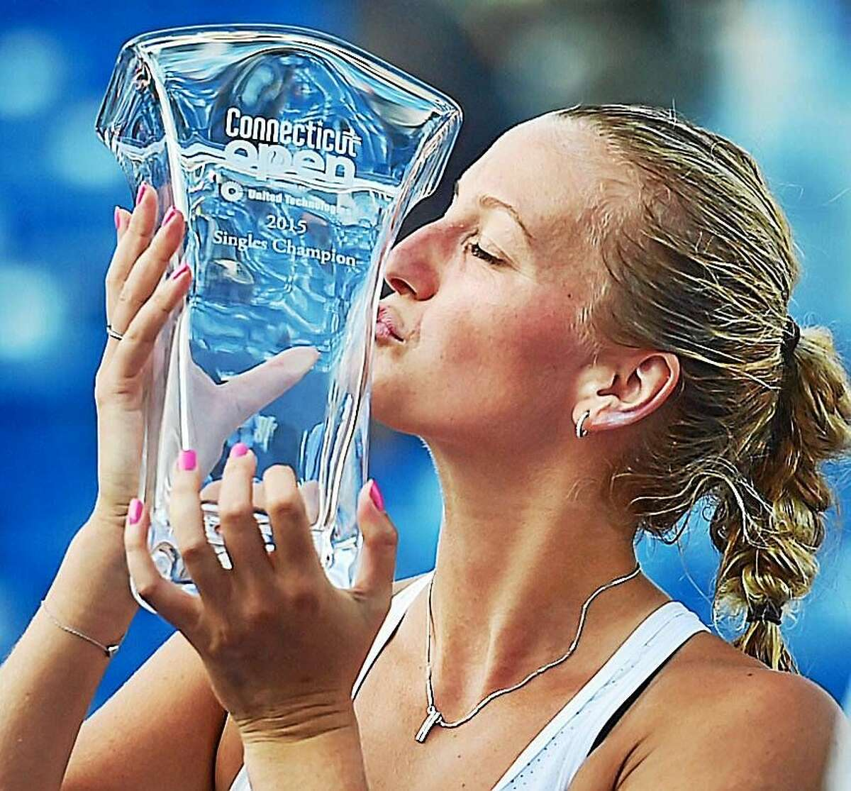 Petra Kvitova kisses the trophy after defeating Lucie Safarova in the final of the Connecticut Open on Saturday at the Connecticut Tennis Center in New Haven.