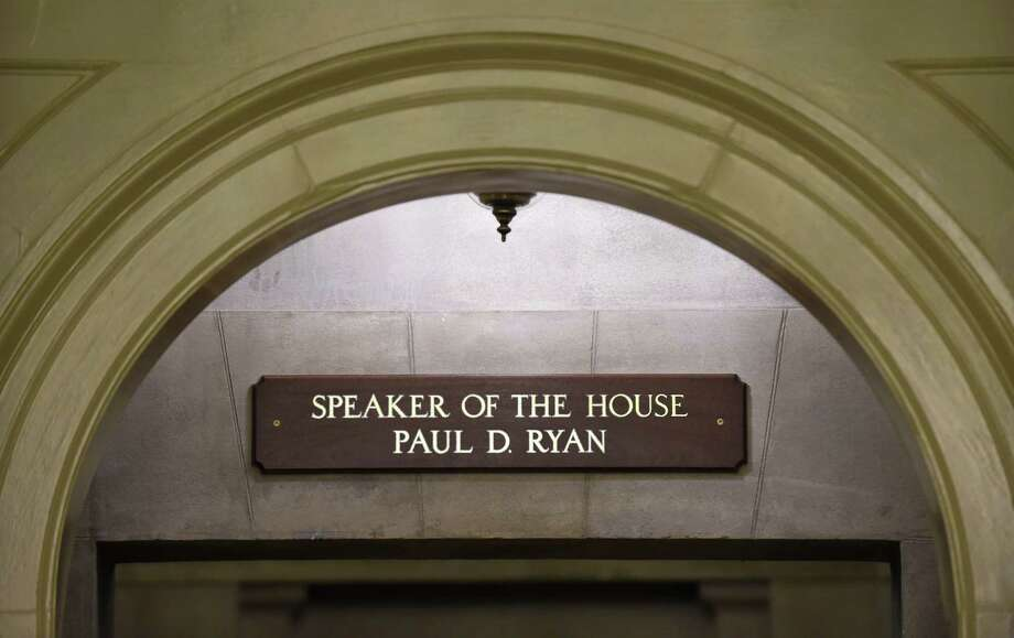 The new sign for new House Speaker Paul Ryan of Wis., is seen above the hallway leading to Ryan's office on Capitol Hill in Washington Friday. Ryan became the 54th speaker of the House on Thursday in a day of high political theater, a young new leader for a fractured Congress, charged with healing Republican divides and quieting the chaos of Capitol Hill. Photo: AP Photo   / AP