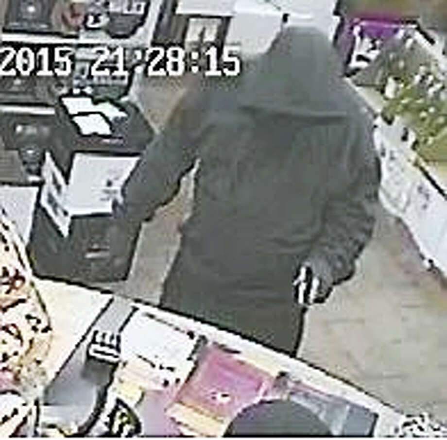 Seymour police are on the lookout for a man who robbed the Crown Liquor store at gunpoint the day after Christmas. Photo: Contributed Photo