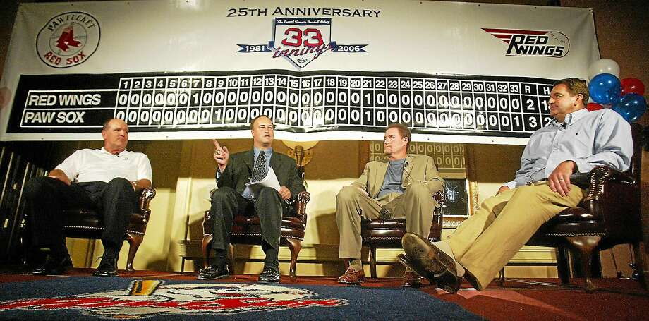 From left, former Pawtucket Red Sox player Marty Barrett, Boston Red Sox broadcaster Don Orsillo, third baseman Wade Boggs and pitcher Bruce Hurst discuss the longest game in baseball history during a 2006 luncheon celebrating the 25th anniversary of the game. After 15 years broadcasting Sox games, Orsillo will be replaced after the season, a move Register sports columnist Chip Malafronte calls the crown jewel of incompetent mismanagement. Photo: Stew Milne — The Associated Press File Photo   / AP2006