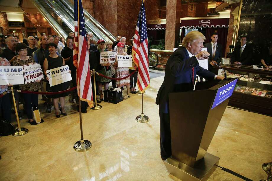 Republican presidential candidate Donald Trump talks about his tax plan during a news conference Monday in New York. The Republican front-runner is calling for an overhaul of the tax code that would eliminate income taxes for millions of Americans, while lowering them for the highest-income earners and business. Photo: AP Photo   / AP