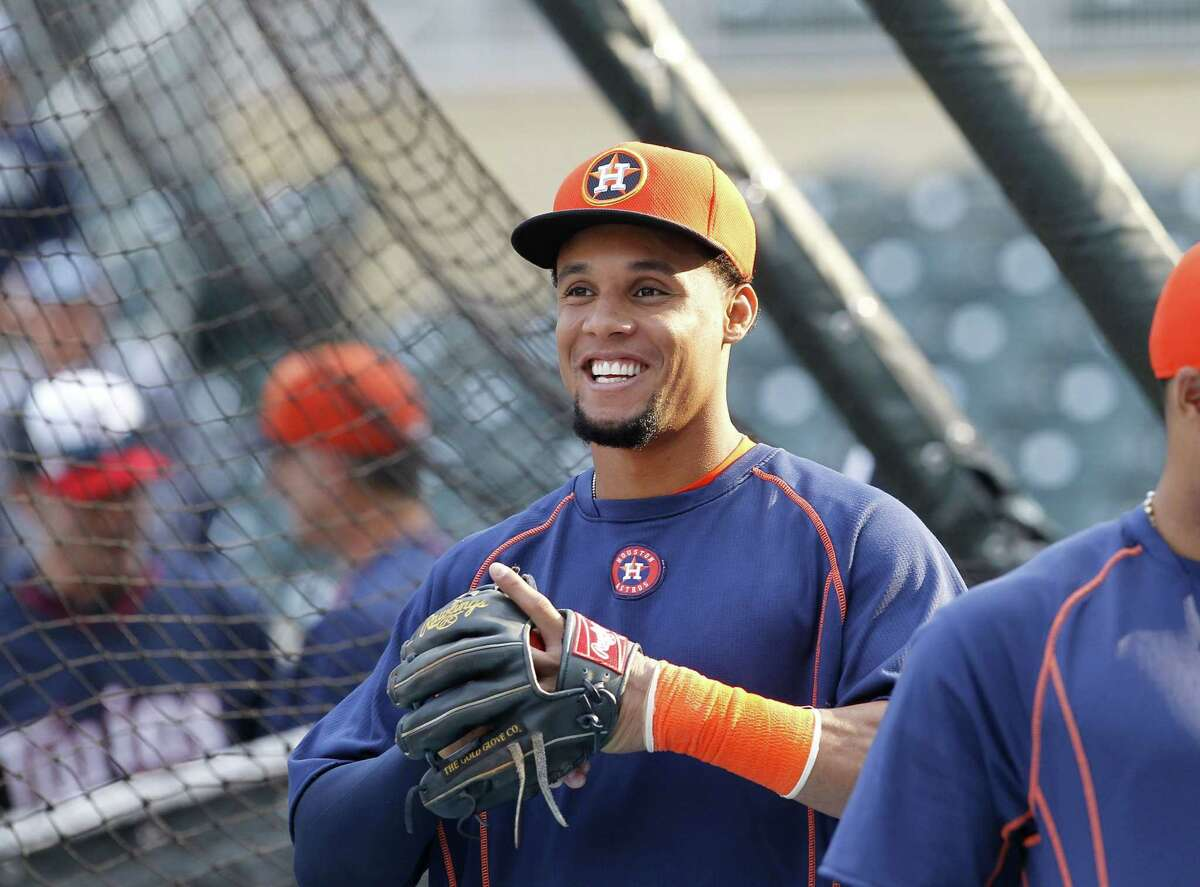 Houston Astros center fielder Carlos Gomez smiles before Friday's game against the Minnesota Twins in Minneapolis.
