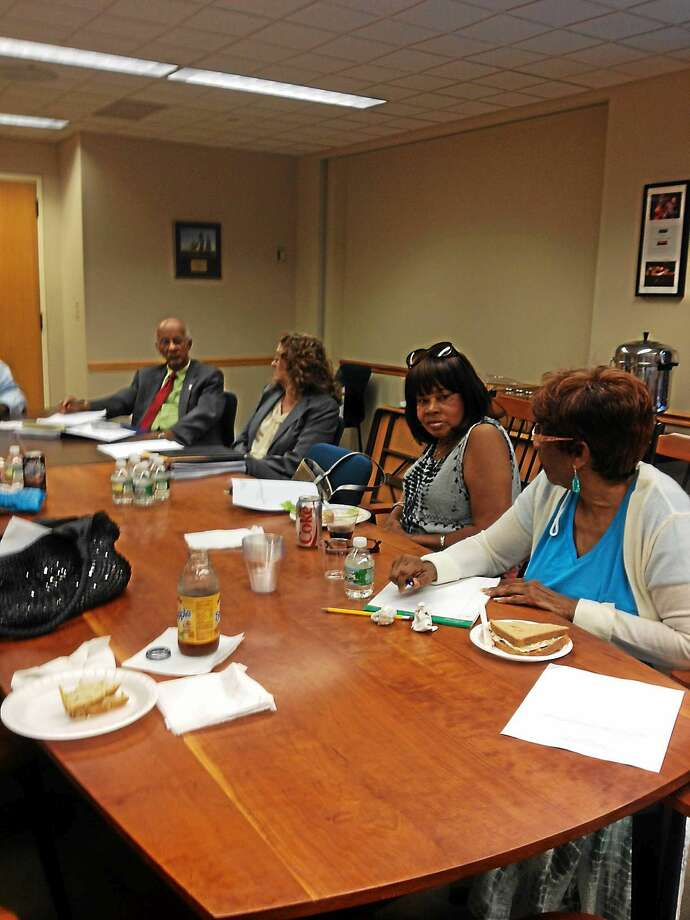 A shot of some Commission on Equal Opportunities board members at a meeting Thursday. From left, Acting Corporation Counsel John Rose; Interim CEO Director Lil Snyder; board members Edith Rawls and Ruth Henderson. Not shown was CEO Chair Juan Scott and Monica Arroya. Photo: Mary O'Leary - New Haven Register