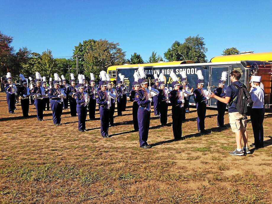 """East Haven High School Co-op Marching Band at the Big E Sept. 23. Students marched in the Connecticut Day Parade while playing the finale piece from their show used in competition, """"Young at Heart."""" Photo: Contributed Photo"""