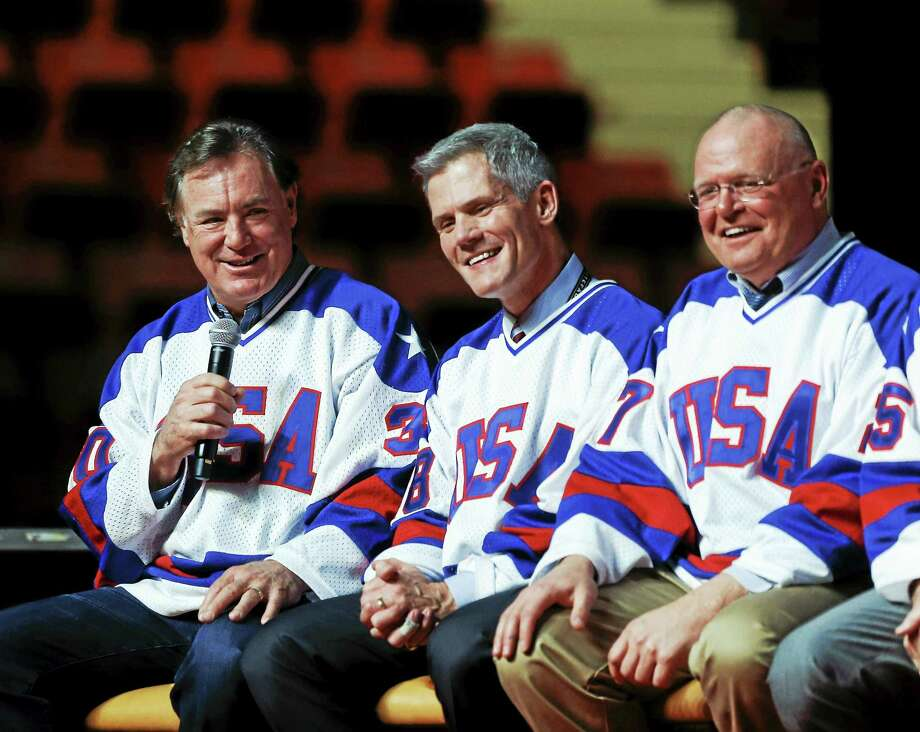 """Jim Craig, left, of the 1980 U.S. hockey team, speaks during a """"Relive the Miracle"""" reunion at Herb Brooks Arena on Feb. 21 in Lake Placid, N.Y. Photo: Mike Groll — The Associated Press File Photo   / AP"""