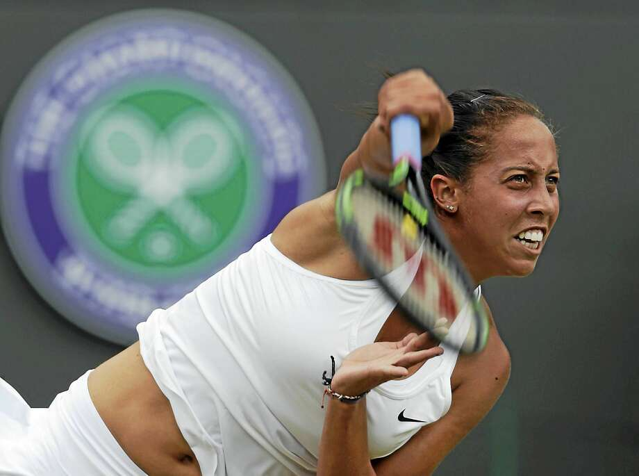 Madison Keys returns to Agnieszka Radwanska during their singles match at the All England Lawn Tennis Championships in Wimbledon, London, earlier this month. Photo: Alastair Grant — The Associated Press File Photo   / AP