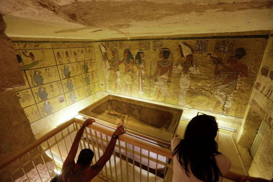 In this Thursday, Nov. 5, 2015, file photo, tourists look at the tomb of King Tut as it is displayed in a glass case at the Valley of the Kings in Luxor, Egypt. On Saturday, Nov. 28, 2015, Egyptian Antiquities Minister Mamdouh el-Damaty said there is a 90 percent chance that hidden chambers will be found within King Tutankhamun's tomb, based on the preliminary results of a new exploration of the 3,300-year-old mausoleum. Photo: AP Photo/Amr Nabil, File / AP