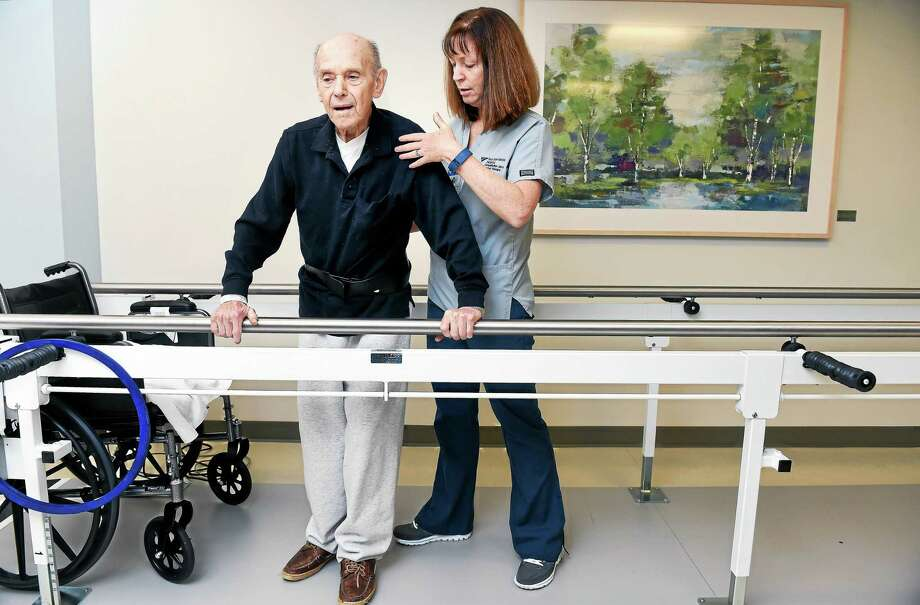 Physical therapist Nancy Hayden assists William M. Cohen of Orange at the new inpatient Yale-New Haven Hospital Rehabilitation and Wellness Center inside Milford Hospital. Photo: Arnold Gold — New Haven Register