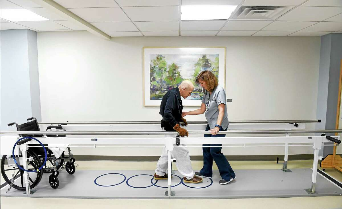 Physical therapist Nancy Hayden assists William M. Cohen of Orange at the new inpatient Yale-New Haven Hospital Rehabilitation and Wellness Center inside Milford Hospital.