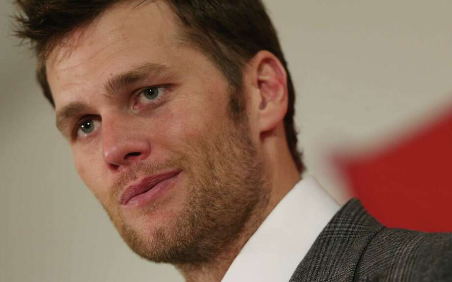 In this Jan. 19, 2014 photo, New England Patriots quarterback Tom Brady reacts to question during news conference after his team's 26-16 loss to the Denver Broncos in the AFC Championship NFL football game in Denver. Brady's four-game suspension for his role in using underinflated footballs during the AFC championship game last season has been upheld by NFL Commissioner Roger Goodell. Photo: AP Photo/David Zalubowski, File   / AP