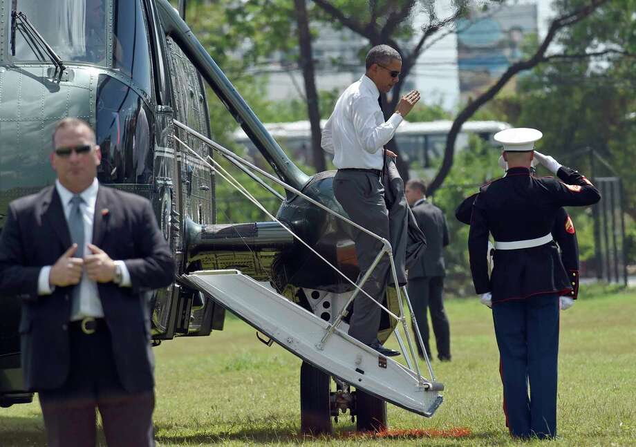 President Barack Obama walks down the steps of Marine One after landing near his hotel in Manila, Philippines, Nov. 17. Photo: Susan Walsh — The Associated Press   / AP