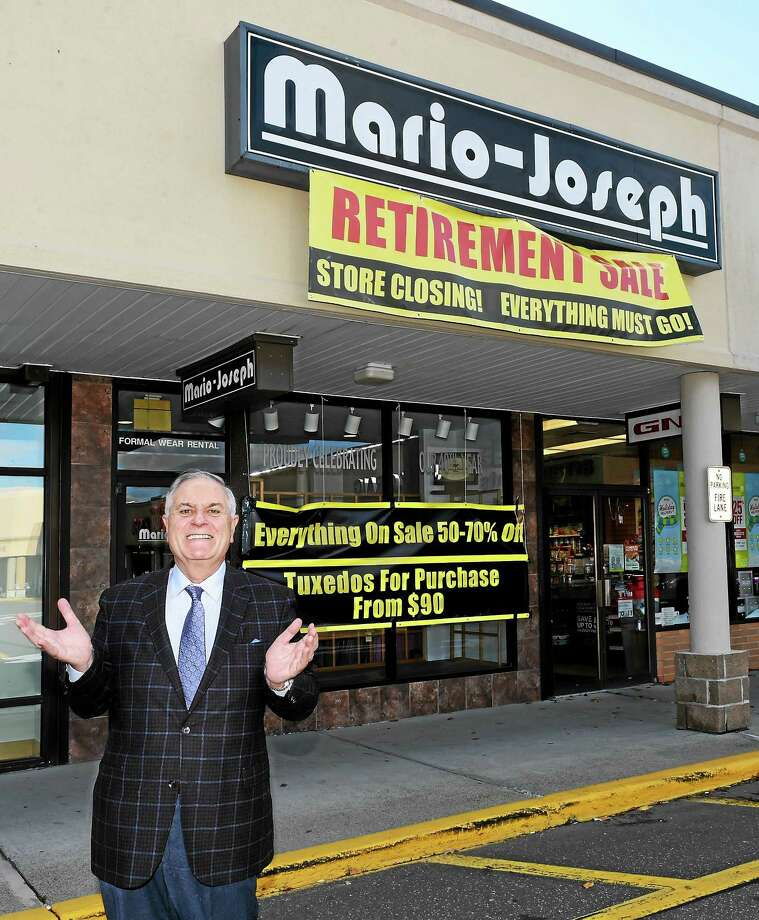 Mario Coppola, owner of Mario-Joseph's Men's Clothing Store in Branford, is retiring after 43 years and closing the business. Photo: Peter Hvizdak — New Haven Register   / ©2015 Peter Hvizdak