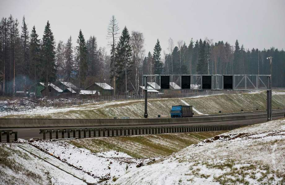 A truck drives along a new highway in Moscow region in this Tuesday, Nov. 17, 2015, photo. As the climate warms, moisture levels are changing with wet areas becoming wetter and dry areas drier. Russia is the fastest warming part of the world, according to a report from the country's weather monitoring agency. The steady rise in temperatures puts Siberia- known for its long winters and lush forests- at risk to natural disasters, such forest fires. Photo: AP Photo/Alexander Zemlianichenko / AP