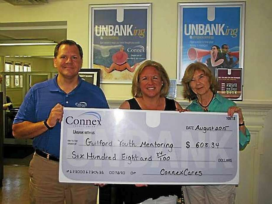 Carl Casper, vice president of customer advocacy for Connex Credit Union, left, presents Lisa Ott, assistant director of Guilford Youth Mentoring Inc., center, and Barbara Solomon, the group's director, with a check for $608.34. Photo: CONTRIBUTED PHOTO