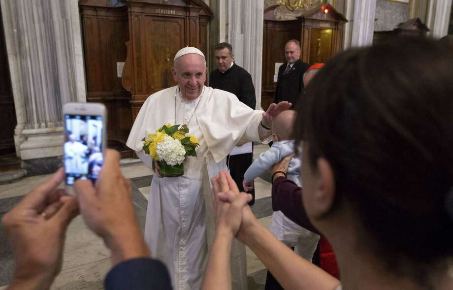 Pope Francis caresses a baby as he arrives to pray in Rome's St. Mary Major Basilica, Monday, Sept. 28, 2015. Pope Francis returned to the Vatican Monday after a 10-day trip to Cuba and the United States. Photo: AP Photo/Riccardo De Luca   / AP