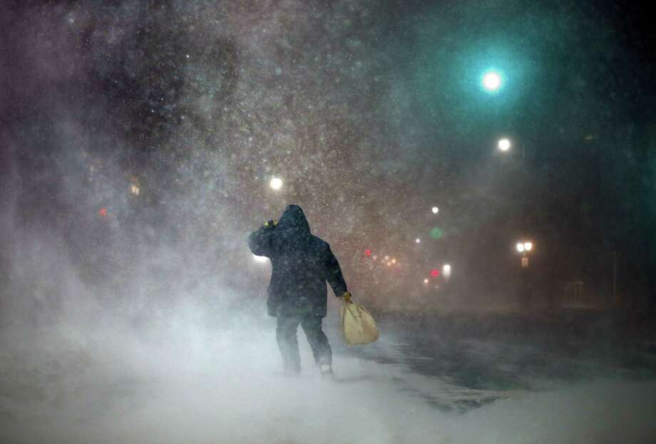FILE- In a Tuesday, Jan 27, 2015 file photo, a man battles fierce headwinds as he walks on Congress Street in Portland, Maine, during a blizzard. The editors of the Maine-based Farmers' Almanac have dubbed their latest forecast a 'winter deja vu,' hearkening to last winter's misery across the Northeast. Photo: (AP Photo/Robert F. Bukaty) / AP
