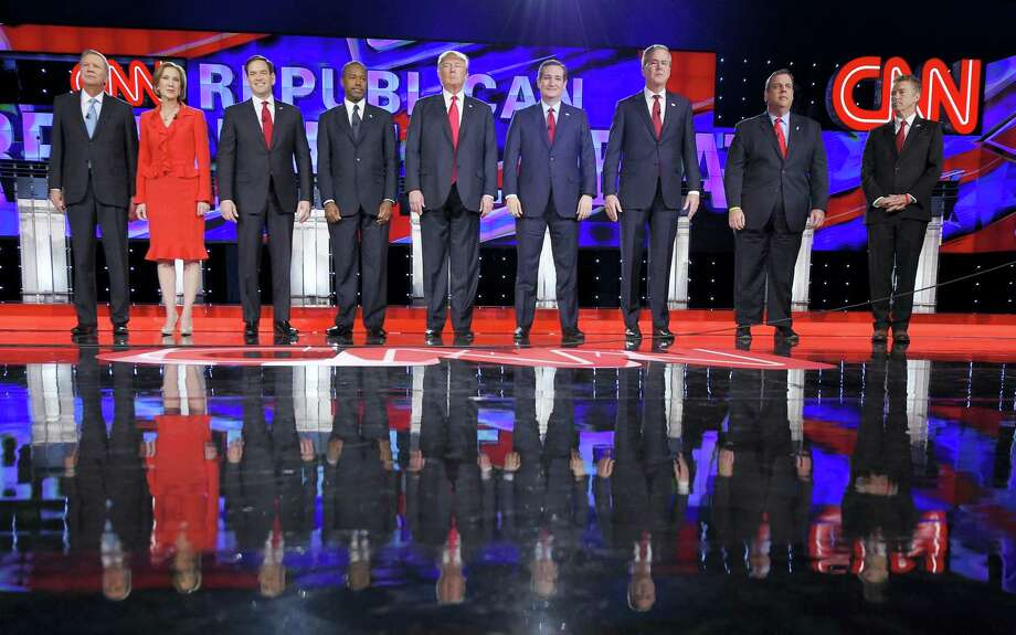 Republican presidential candidates, from left, John Kasich, Carly Fiorina, Marco Rubio, Ben Carson, Donald Trump, Ted Cruz, Jeb Bush, Chris Christie, and Rand Paul take the stage during the CNN Republican presidential debate at the Venetian Hotel & Casino on Tuesday, Dec. 15, 2015, in Las Vegas. Photo: (AP Photo/Mark J. Terrill) / AP