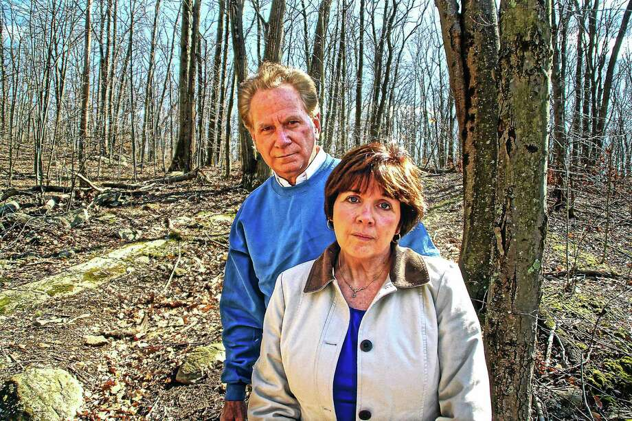 In this April 2, 2012, file photo, Jan and Bill Smolinski stand in a wooded area in Shelton. Photo: Peter Casolino — New Haven Register