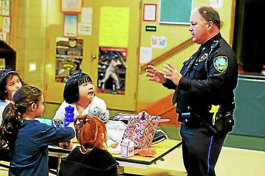 East Haven Police Officer Dave Torello, D.A.R.E. program officer, with Tuttle School fourth-graders during lunch in East Haven Friday. Photo: Peter Hvizdak - New Haven Register