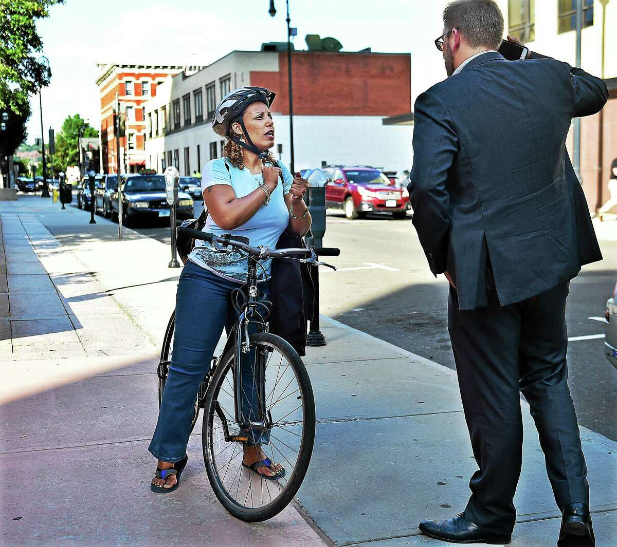 Doug Hausladen, the Director of Transportation, Traffic & Parking talks to a bicyclist who still prefers sidewalks over the bike path in New Haven, Wednesday August 26, 2015.