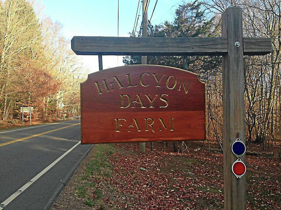 A sign for Halcyon Days Farm outside the large property in Killingworth where a couple was found shot to death. Photo: Ryan Flynn — New Haven Register