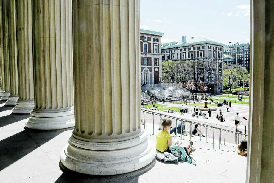 Students sit on the steps of Columbia University's Low Memorial Library in New York. Photo: Mark Lennihan — The Associated Press   / AP